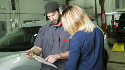 Lady Discussing with Mechanic