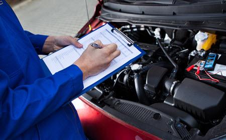Mechanic Checking Mercedes-Benz